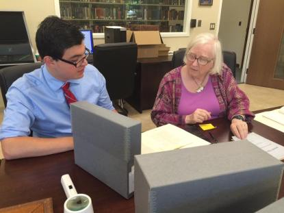 Christian helps a researcher find ancestors who attended the JFA.